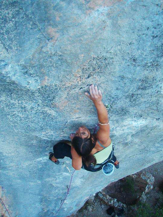 Steffi Sexton rock climbing like a champ with her astrological bangle on right elbow