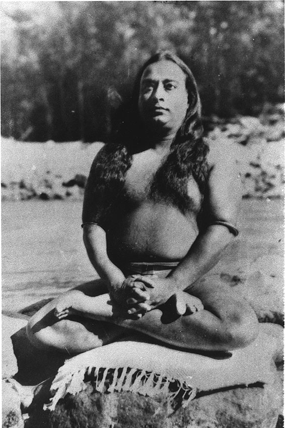 Paramhansa Yogananda wearing astrological bangle meditating in lotus pose